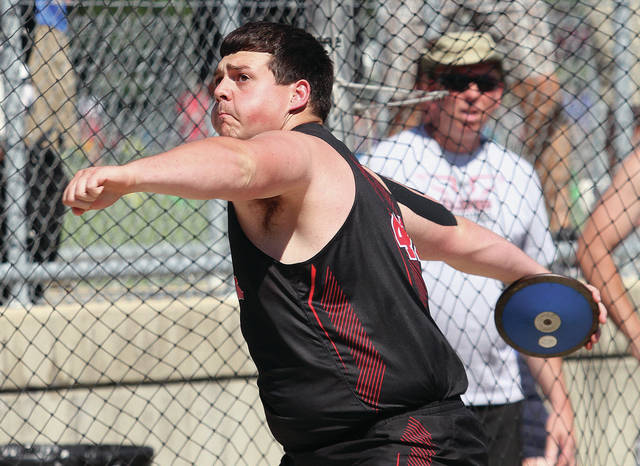 Fort Loramie's Collin Detrick competes in the discus during the division III regional track meet on Wednesday at Troy Memorial Stadium in Troy.