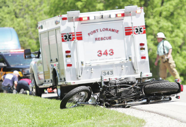 Fort Loramie Rescue workers tend to a man whose motorcycle crashed at the intersection of state Route 47 and Hardin-Wapakoneta Road around 2 p.m. Friday, May 25. CareFlight was called to pick the man up from Wilson Health. The Shelby County Sheriff's Office is investigating.