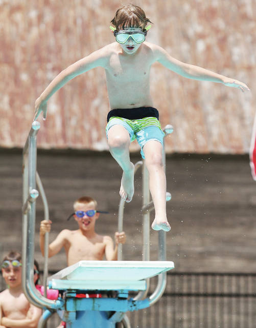 Logan Brearley, 7, of Botkins, son of Amy and Dan Brearley, jumps off the high board at Botkins Memorial Pool Wednesday, May 30. The pool just opened the day before. Pool hours are Monday through Thursday from noon to 8 p.m. and Friday to Sunday from noon to 7 p.m..