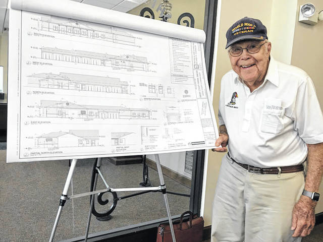 Bob Sargeant, of Sidney, looks over plans for the animal shelter that will be named for him and his family, Tuesday, May 15, in the chambers of the Shelby County commissioners in Sidney.