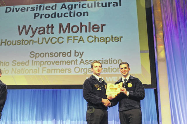 Houston-UVCC FFA member, Wyatt Mohler, left, is recognized at the State FFA Convention for winning his State Proficiency Award in the area of Diversified Agricultural Production.