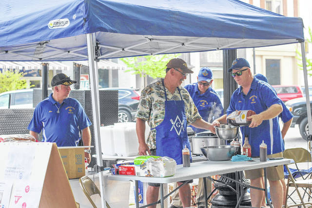"Masonic Temperance Lodge 73 prepared barbecue dinners during Saturday's Farmers' Market. Working at the stand were, left to right, Nate Phillips, Sidney, Brian Huffman ""Road Dog BBQ,"" Sidney, Michael Supinger, Russia, and Terry Cupp, Sidney."