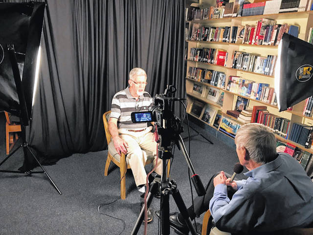Chuck Price, right, interviews John Moeller, both of Sidney, recently, during the making of a video chronicling the history of Christian Academy Schools. Moeller was a founder of the school and sat on its board for many years.