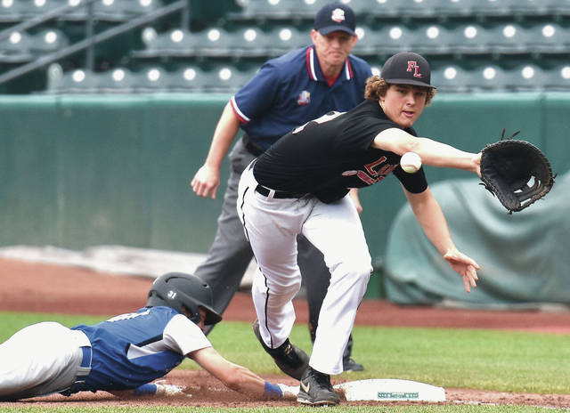 Fort Loramie's Nathan Raterman tries to pick off Trinity's Ryan Foss at first base during a Division IV state semifinal on Thursday at Huntington Park in Columbus. Raterman is one of three starters Fort Loramie could start in the Div. IV final on Saturday.