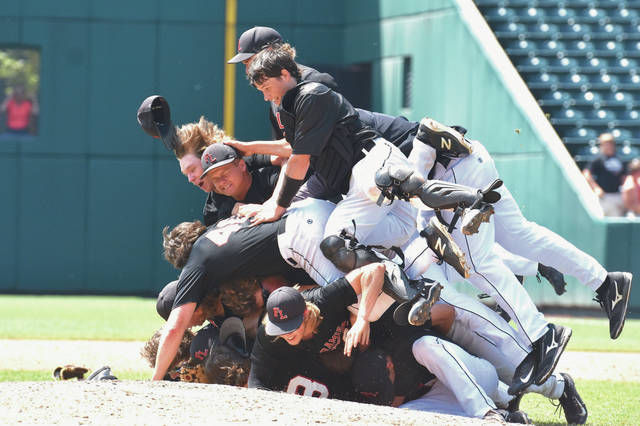 Fort Loramie players form a pile after defeating Hicksville 8-4 in the Division IV state championship game on Saturday at Huntington Park in Columbus. The Redskins scored eight runs in the fifth inning to battle back from an early 4-0 deficit.
