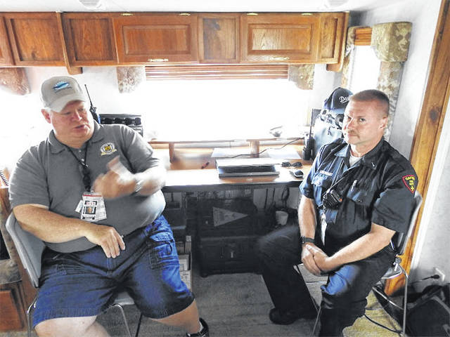 Todd Rardon and Lt. David Andes relax in the mobile command center during the Vectren Dayton Air Show in Vandalia, recently.