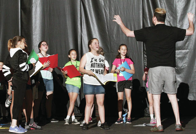 "Camp director John Young, of Huber Heights, directs a group of kids, Tuesday, June 5, enrolled in the Historic Sidney Theatre's summer theatre camp for kids aged 6-15. The camp will culminate in a production of ""Pirates! The Musical"" Friday, June 8."