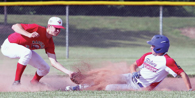 Sidney Legion Post 217's Austin McClain is tagged out by Napolean Post 300's Bryce Williams at second base during a game at Custenborder Field on Wednesday.