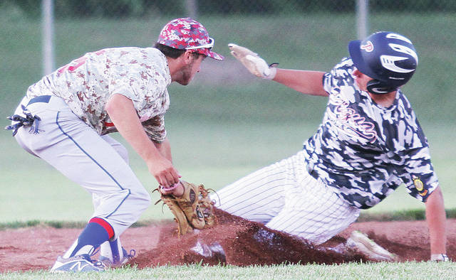 Sidney Post 217's Austin McClain tags out Piqua Post 184's Rylee Deitsch during a game on Wednesday at Custenborder Field.