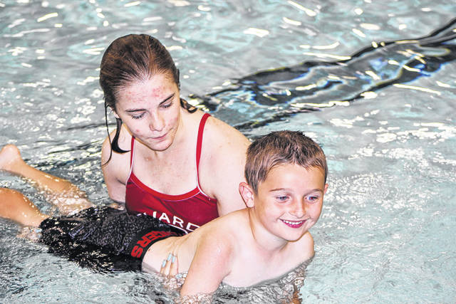 The 32nd Water Safety Week is underway at the Sidney-Shelby County YMCA. Lifeguard Lily Schaeffer, of Fletcher, helps Ethan Baker, 6, learn how to move his arms in the water while holding his breath. Ethan is the son of Rick and Emily Baker, of Fletcher. The event is sponsored by the Sidney Daily News, Minster Bank, Ruese Insurance and Frickers.