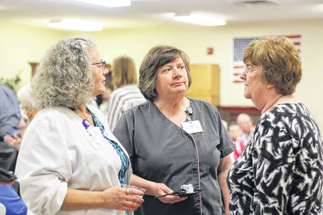Sally Yeager, right, talks with Registered Nurse Joy Eyler, left, and Janet Martin, of the housekeeping department, at Ohio Living Dorothy Love, Friday, June 1, during a reception there honoring Yeager. She retired as the facility's independent housing director after 31 years of service.