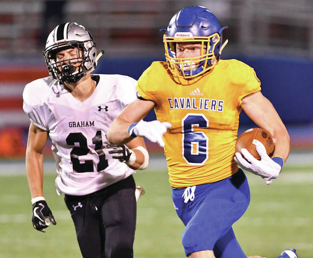 Lehman Catholic's Owen Smith, right, runs by Graham's Layne Brayton during the fourth quarter of a of a nonconference game on Sept. 9, 2017 at Alexander Stadium in Piqua. Smith rushed for 1,727 yards and 21 touchdowns last year on 152 carries and was named the NWCC player of the year.