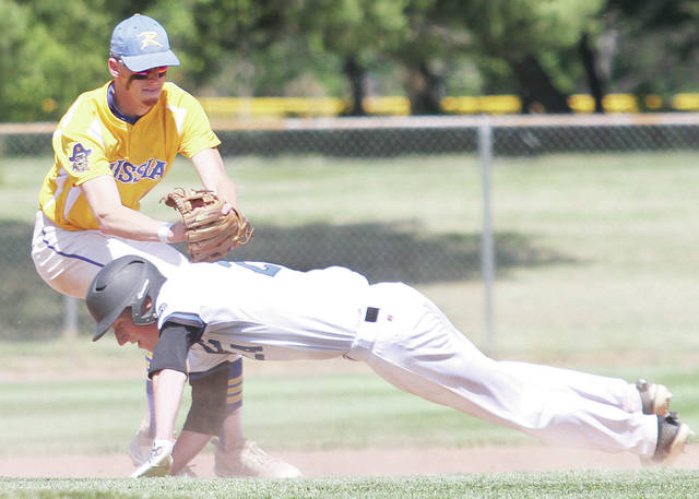 Luke Gronneberg | Sidney Daily News file Russia's Hunter Cohee tags out Cincinnati Christian's Mitchell Smith between first and second during a Division IV regional semifinal this spring at Carleton Davidson Stadium in Springfield.