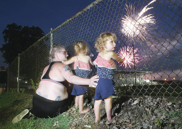 Watching the Sidney fireworks Wednesday, July 4 from the Shelby County Fairgrounds are, left to right, Christy Osborne, and her twin daughters Heaven Osborne, 2, and Neriath Osborne, 2, all of Sidney.