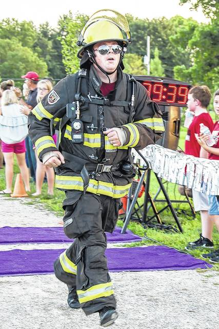 Kenneth Krumn, of New Bremen, runs the 2017 Firemen's Memorial 5K in full gear Friday, July 21. Krumn has been running the 5K in fire gear since 2011. The 5K is part of the New Bremen Firemen's Picnic. This year's 5K will be held July 27, at 8 p.m.