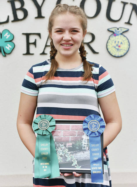 Chloe Weigandt, 14, of Sidney, daughter of Jason and Gwen Weigandt, a member of Successful 4-H Club, won Outstanding of the day and state fair qualifier in miniature gardening at the fair.