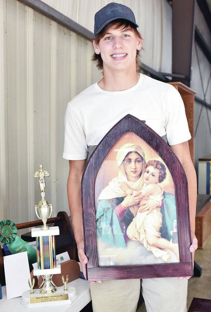 "Evan Poeppelman, 17, son of Tom and Laura Poeppelman, a member of McCartyville Producers, won best of class, outstanding of the day and state qualifier in ""Finishing Up"" woodworking."