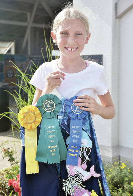 Marie Ballas, 10, of Fort Loramie, daughter of Karen Ballas, member of Merry Mod Makers, won state fair qualifier in active sportswear - modeling at the fair.
