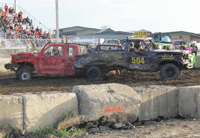 Rich Sarringer, left, of Portland, and Aaron Maxson, of Wapakoneta, take part in the truck demolition derby at the fair Saturday, July 28.