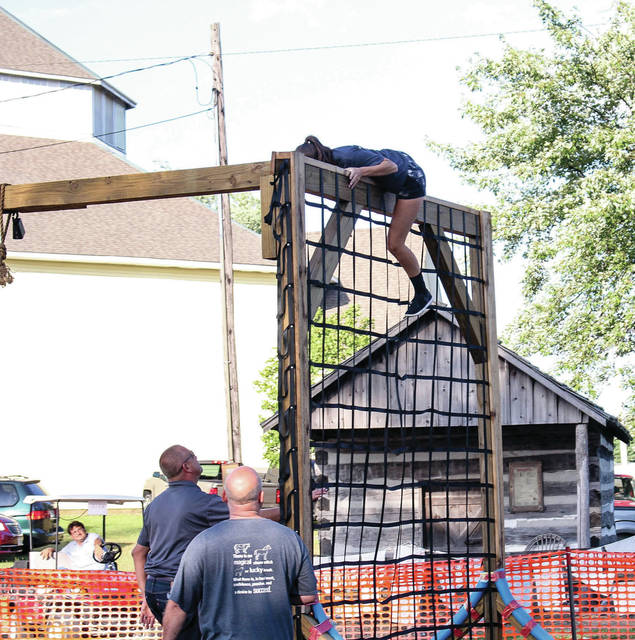 Maria Booher, 15, of Houston, daughter of Scott and Gayette, competes on the Ninja Warrior course at the fair Saturday, July 28.
