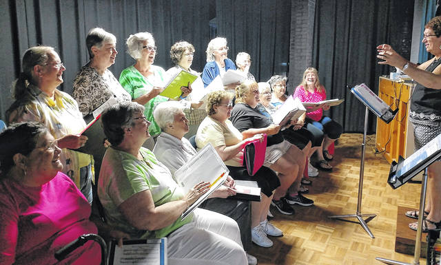 The Senior Center Singers rehearse for an appearance with the Sidney Civic Band, scheduled for July 6, on the courtsquare in downtown Sidney.