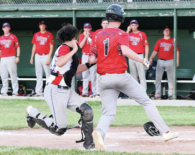 Ottawa Post 63's Mike Bowers is tagged out at home by Sidney Post 217 catcher Darren Hoying during an American Legion game on Monday at Custenborder Field. The out was the final of the game and preserved the 3-2 win for Post 217.