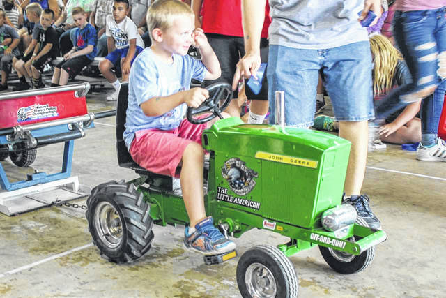 Grant Cleveland, 5, son of Sara and John Cleveland, of Houston, participates in the Kiddie Tractor Pull on Thursday afternoon at the Shelby County Fair.