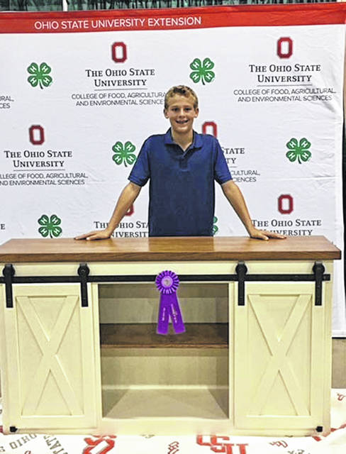 """Nate Boerger, 14, son of Gina and Kevin Boerger, of Fort Loramie, won Outstanding of the Day at the 2018 Ohio State Fair for his woodworking project, """"Nailing It Together."""" He is a member of the Merry Mod Makers 4-H Club."""