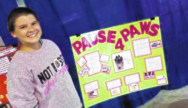 Deanna Rodeheffer, 12, daughter of Brenda and Scott Rodeheffer, of Fort Loramie, placed 10th at the 2018 Ohio State Fair with her dog poster. She is a member of Shelby County Paw Prints 4-H.