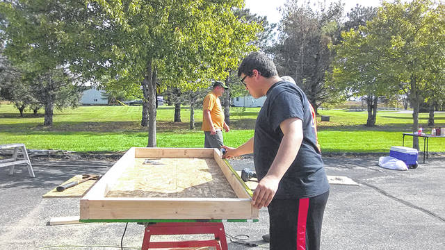 Jeffrey Nickels, 16, son of Rebecca and Tyler Stalder, of Minster, works on a project to restore a shed. Nickels served as project leader to earn the Eagle rank in Boy Scouts.