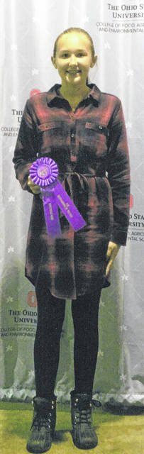 """Eliza Gariety, 13, daughter of Connie and Greg Gariety, of Russia, earned an Outstanding of the Day at the 2018 Ohio State Fair with her """"Look Great for Less"""" 4-H project. She is a member of the Russia Fashionettes 4-H Club."""