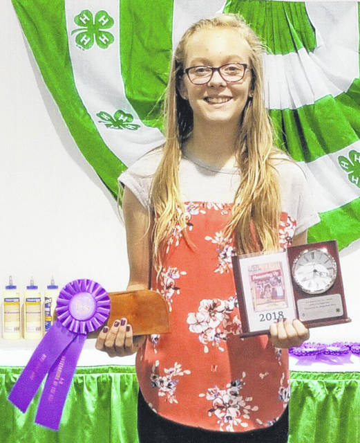 Emma Brunson, 11, daughter of Mark and Kelli Brunson, of Anna, received Outstanding of the Day and was the clock trophy winner with her Measuring Up Level 1 woodworking project at the 2018 Ohio State Fair. She is a member of the McCartyville Producers 4-H.