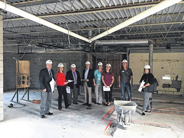 Shelby County commissioners and others stop for a photo while touring the construction site of an addition to the Fair Haven Shelby County Home in Sidney, recently. Pictured, left to right, are Commissioners Tony Bornhorst, Julie Ehemann and Bob Guillozet; Dan Freytag, architect with Freytag & Associates Inc.; Anita Miller, Fair Haven administrator; Adrianne Miller; Greg Miller, Fair Haven head of maintenance; and Amy Schwieterman, of Freytag & Associates.