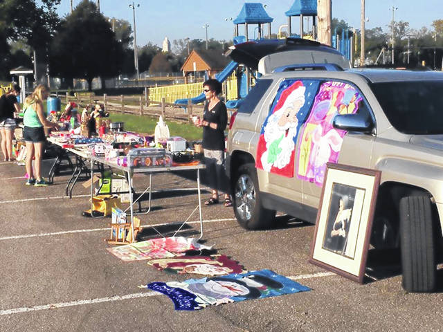 Buyers and sellers enjoy the United Way's Power Junk in the Trunk sale in 2017. This year's event will be Sept. 22.