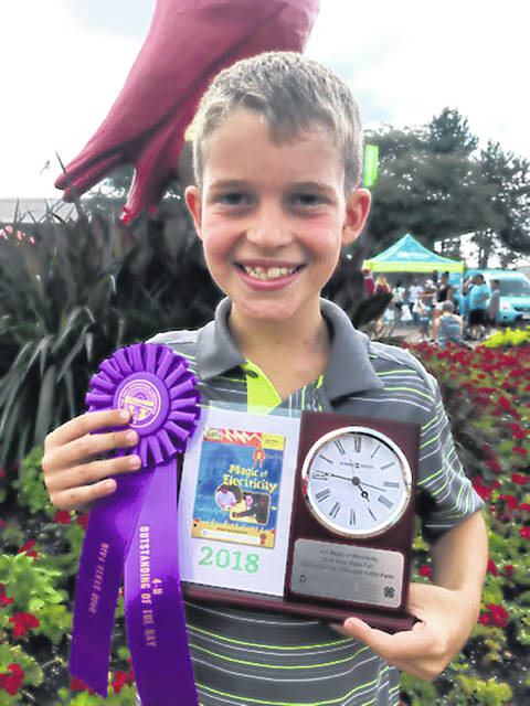 Kale Barhorst, 9, son of Amanda and Chris Barhorst, of Maplewood, earned Outstanding of the Day and a clock trophy for his project, Magic of Electricity, at the 2018 Ohio State Fair. He is a member of Creative Clovers 4-H.