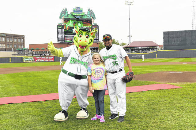 Anna Neu, of Sidney, threw the first pitch out at the July 21 Dayton Dragons baseball game. Anna raised $255 from ticket sales for the Jingle Bell Run in December.