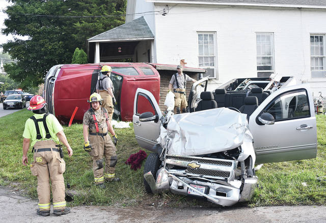 Responders check out the scene of a fatal crash, Thursday, Aug. 2, at the intersecction of state Route 47 and Hardin-Wapakoneta Road. Dailan D. Day, 24, of Lockington, was pronounced dead at the scene.