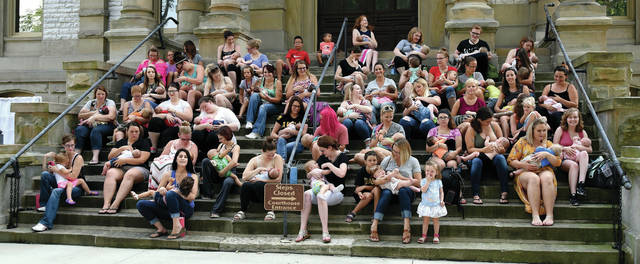 The Big Latch on takes place at the Shelby County courthouse steps Saturday, Aug. 4, to promote public breastfeeding. Forty-seven moms and their babies and toddlers participated in the event. A total of 111 people, which includes dads and children, signed in for the event, said organizers.