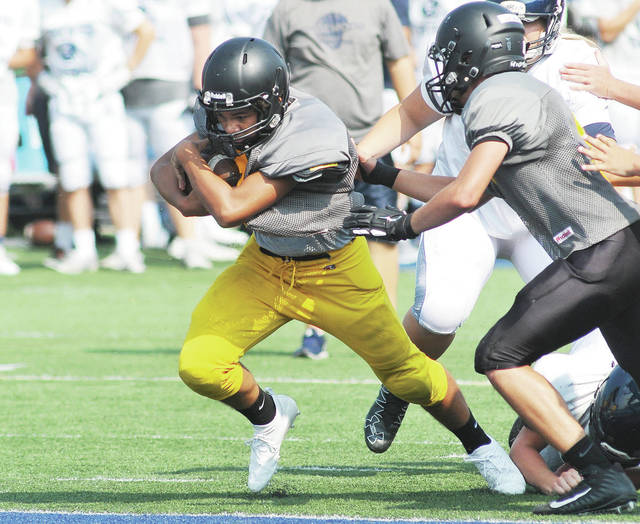 Sidney's Donavin Johnson runs for a short touchdown against Edgewood during a quad scrimmage on Saturday in Trenton. Johnson, a freshman, is one of four quarterbacks that played for the Yellow Jackets.