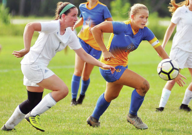 Lehman Catholic's Grace Olding, right, chases for the ball with Springfield Catholic Central's Abby Erter during a nonconference game on Saturday in Sidney.