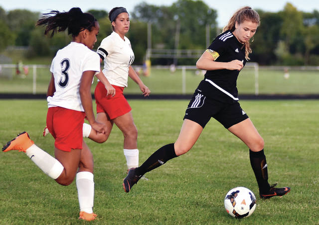 Sidney's Elaine Wiesenmayer chases Bellefontaine players during a nonconference game on Wednesday in Sidney.