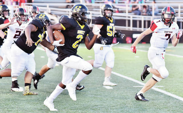 "Sidney freshman Quamir ""Philly"" Brown runs during a nonconference game against Bellefontaine on Thursday at Sidney Memorial Stadium."