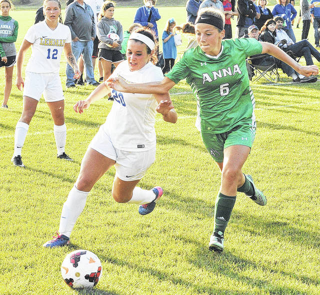 Anna senior midfielder Kelsie McKinney, right, and Lehman Catholic's Samantha Edwards chase after the ball during a Western Ohio Soccer League game on Oct. 5, 2017. McKinney is one of four returning seniors for the Rockets this season.
