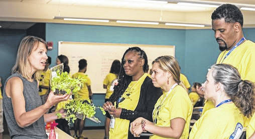 Michelle Fleming, left, director of Wright State's Early Childhood Education Program, instructs educators during an Air Camp session at the university. The camps taught teachers how to use aviation and aeronautics as a learning vehicle for their students.