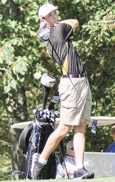 Botkins senior Nick Fischio watches a ball during a golf invitational last season. Fischio, who qualified for regionals last year, was medalist with a 74 at the Shelby County preview on Monday.