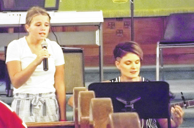 Botkins resident Lizzie Cooper is accompanied by Kristin Vaubel during the 2016 Music Fest.