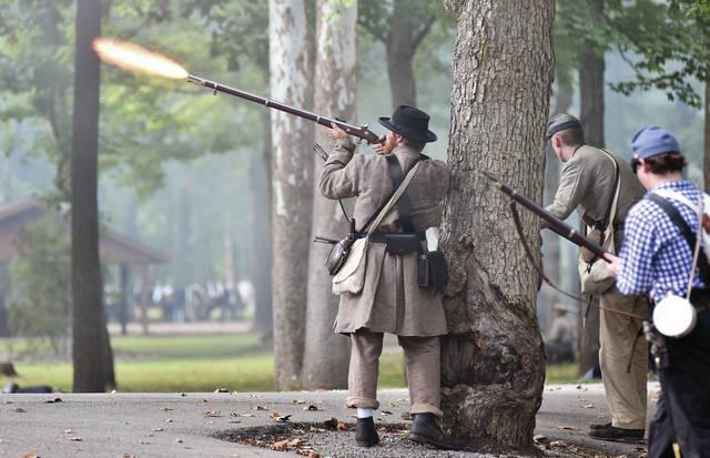 A Confederate soldier fires at the Union army during a Civil War reenactment at Tawawa Park Saturday, Sept. 15. Another battle will be held at 7 p.m. Saturday Sept. 15 and Sunday, Sept. 16 at 2 p.m.. Other activities will be held during the day.
