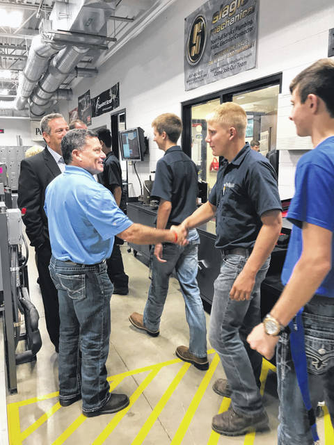 HVAC/R students introduce themselves to Rep. Rick Perales as he visits their lab.