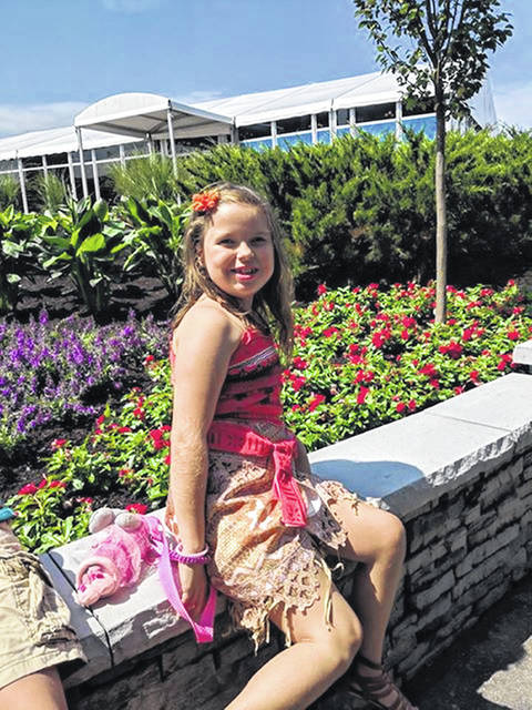 """Rozlyn """"Roz"""" Abbott, 8, daughter of Anne and Matthew Abbott, of Sidney, will be throwing out the first pitch of the baseball game between the Reds and San Diego Padres Friday night."""