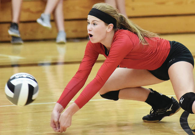 Fort Loramie freshman Ava Sholtis dives for the ball during a nonconference match against Versailles on Saturday in Fort Loramie. Sholtis had 10 kills to help the Redskins rally and earn a 3-2 win.